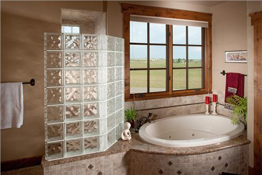 Master bathroom with beige tones and glass block.