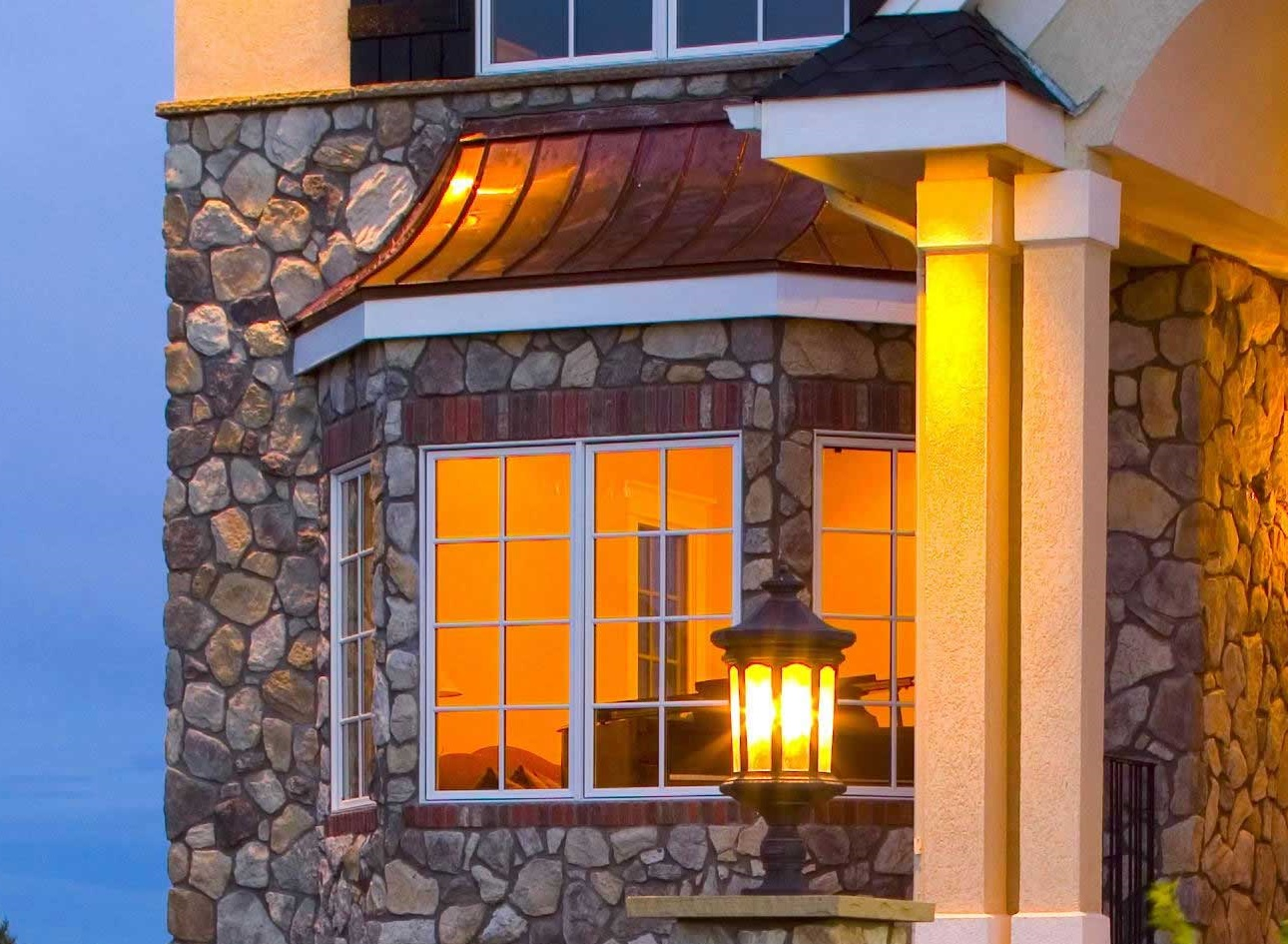Bay window with stone accents in luxury home.