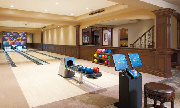 These homeowners know how to enjoy life, and it is evident as visitors enter the lower level of their home, complete with 8,300 square feet of entertainment options. This includes the Brunswick bowling lanes, which can be transformed to cosmic bowling with a flip of a switch.