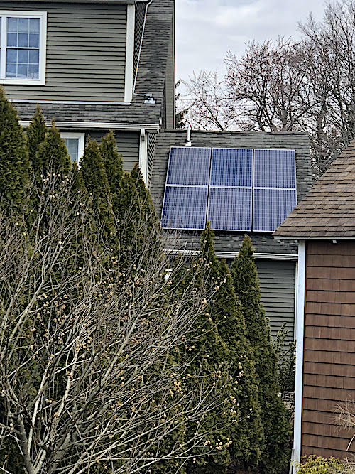 Solar panels on part of the roof of a home
