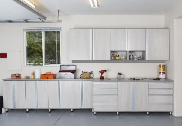Well organized garage with storage cabinets