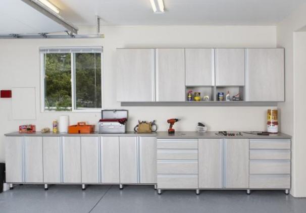 Well organized garage with storage cabinets