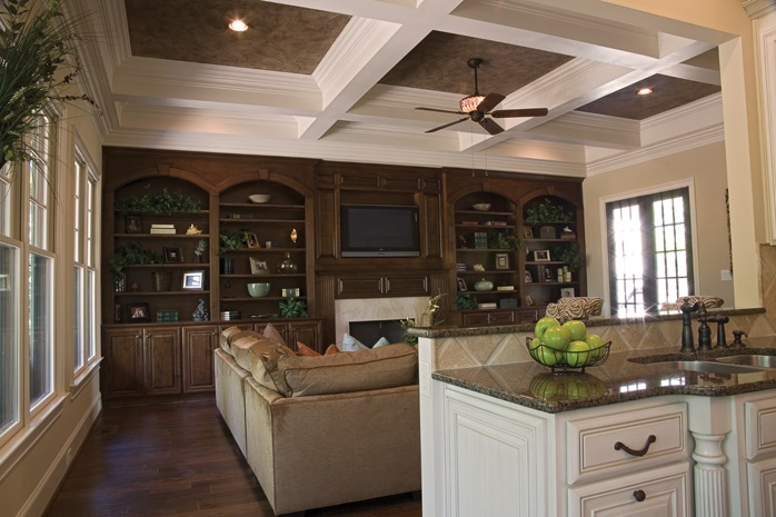Example of coffered ceiling in this open floor plan looking out from kitchen to family room.
