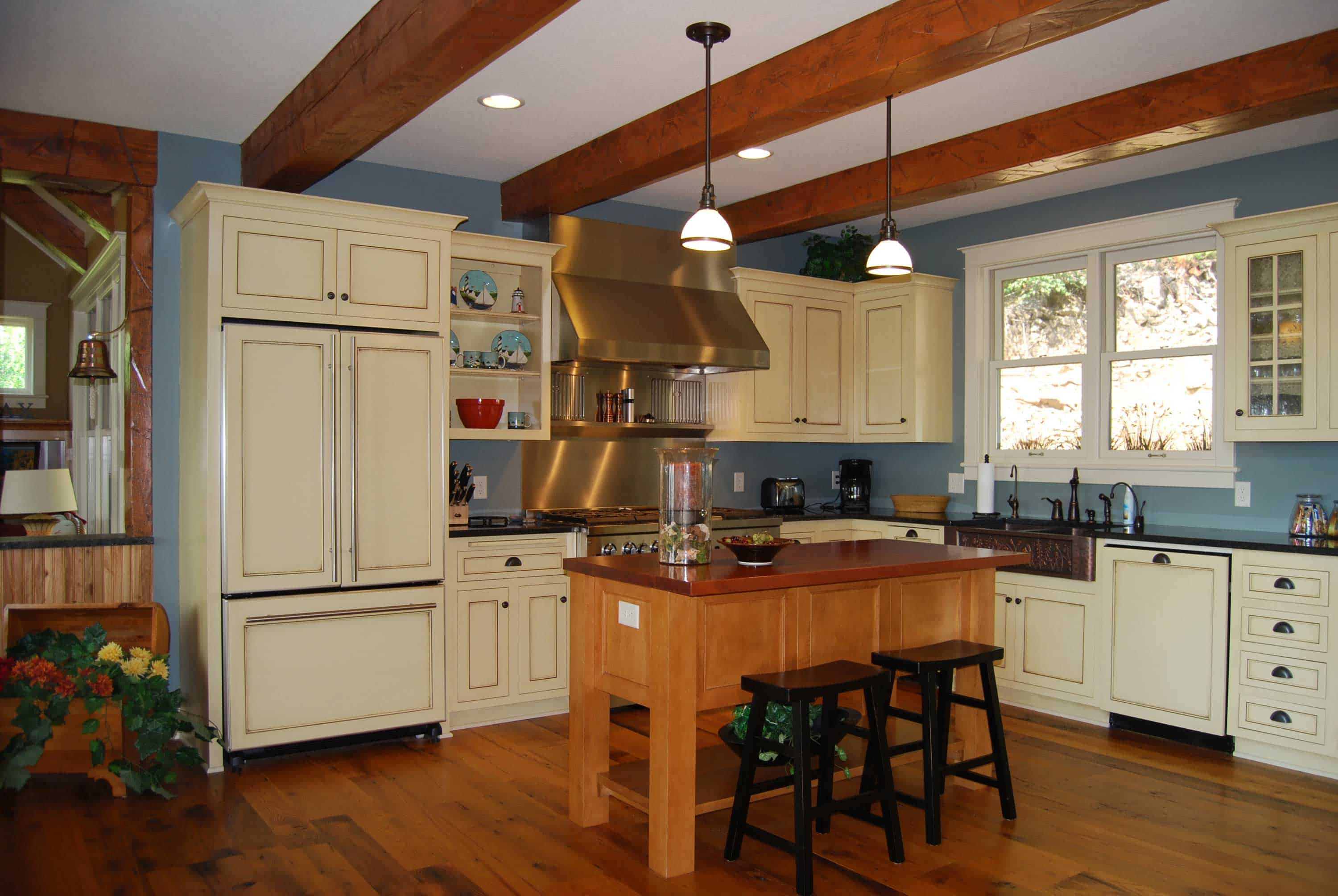 Country kitchen with cream, blue, and hardwood.