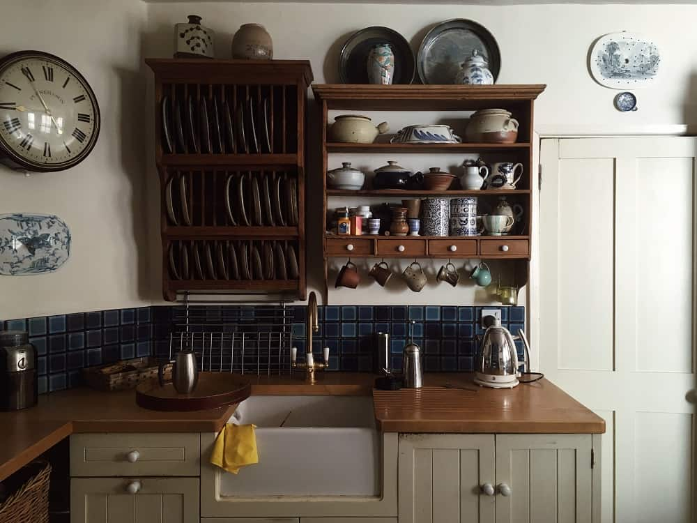 Country-style kitchen with wooden, vintage shelves