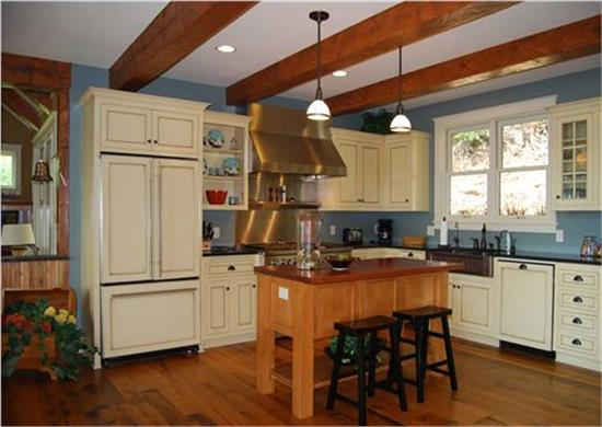 Country kitchen with butcher's block as kitchen island