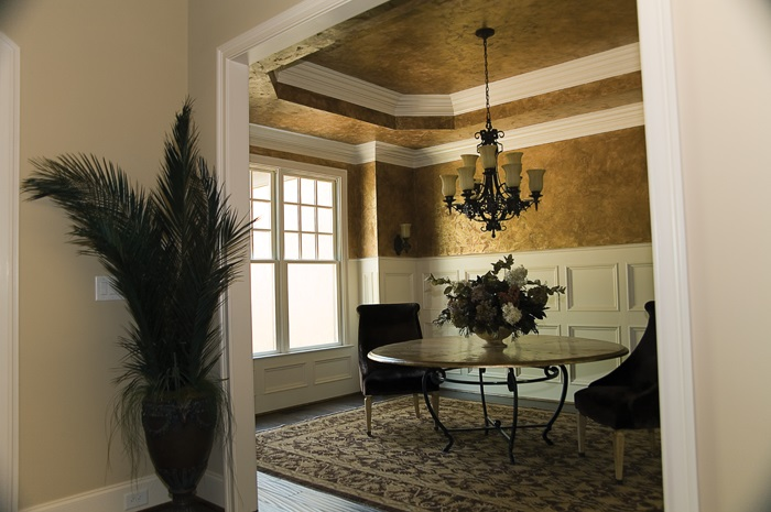 Dining room with elaborate application of crown molding.