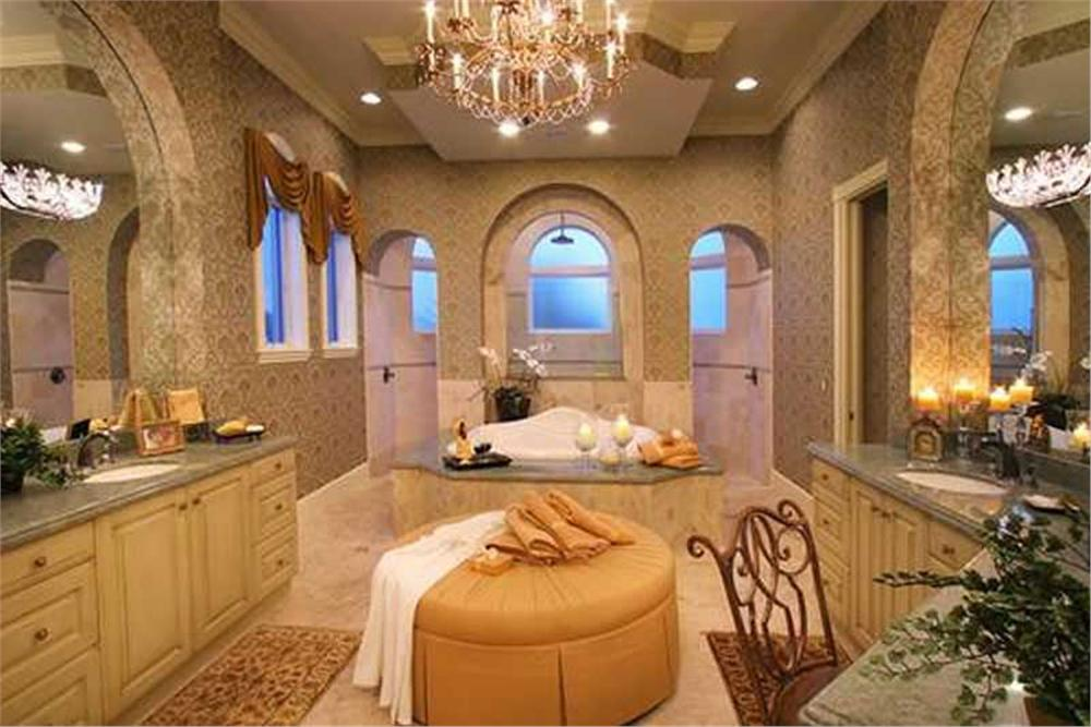 Enormous master bathroom with large walk-through shower behind tub