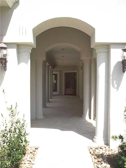 Detail of long walk and arches of this courtyard entry to the main door of the house