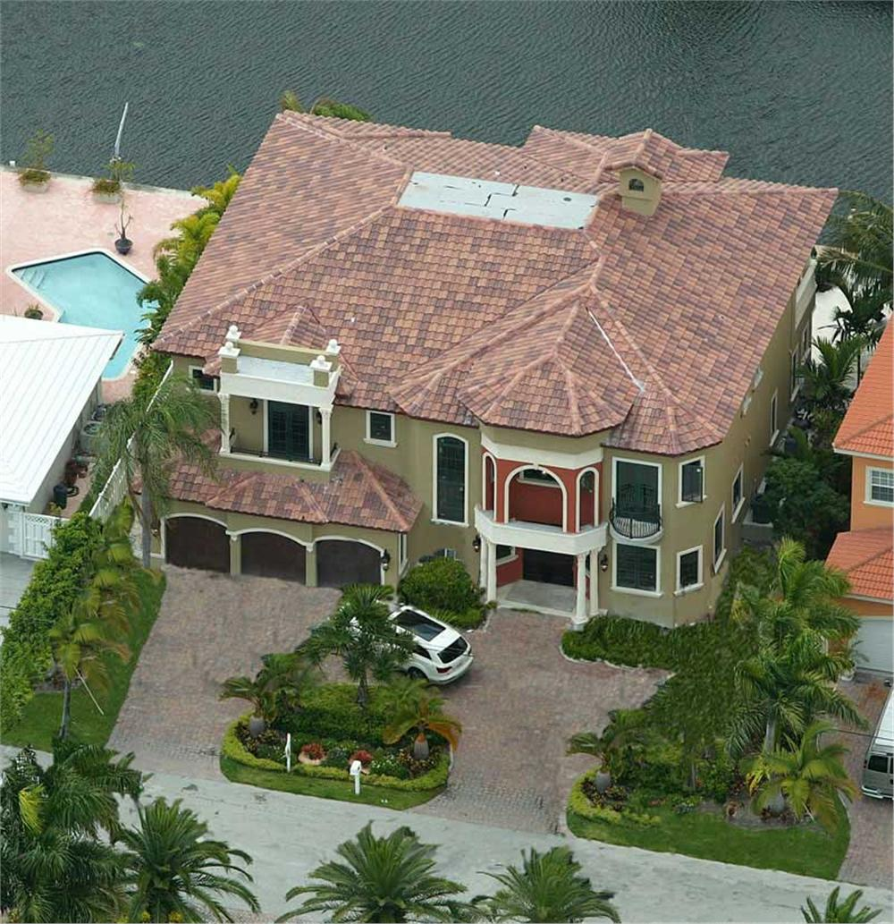 Overhead view of Mediterranean style home on the water