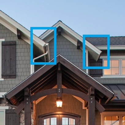 Example of luxury home with eaves highlighted in blue.