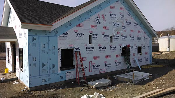 Home sheathed with foam-board sheathing