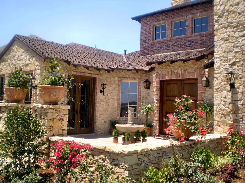 Courtyard fountain fits in well with the architecture of this Southwest - Tuscan style home