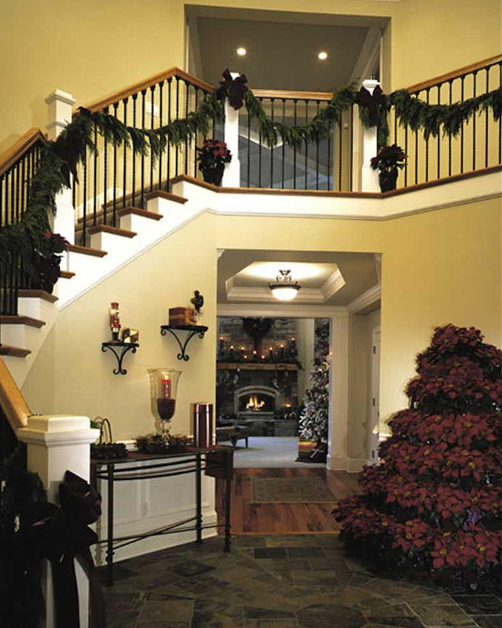 Foyer with tree made of poinsettias.