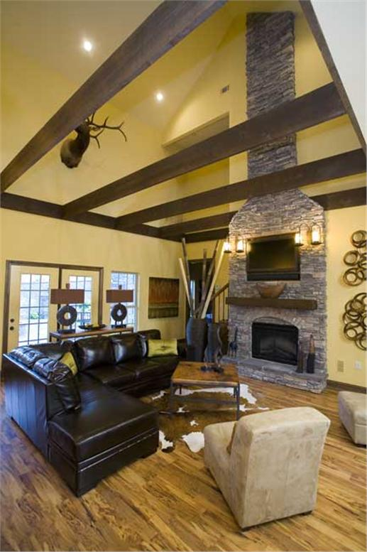 Soaring ceiling and fireplace of Country style Great Room