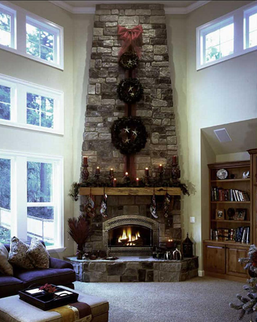 Great room with stacked wreaths over the fireplace.