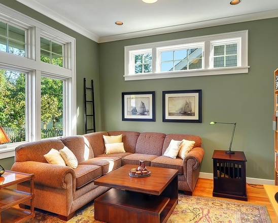Living room with green walls and comfortable decor