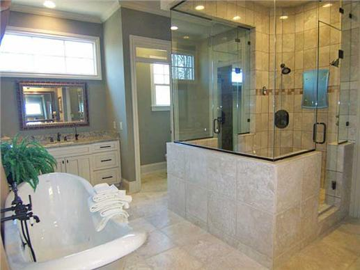 Luxury master bathroom in this Modern home design.