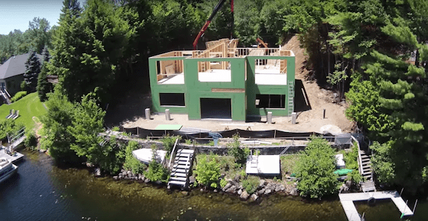 Lakeside home being erected using prefabricated panels