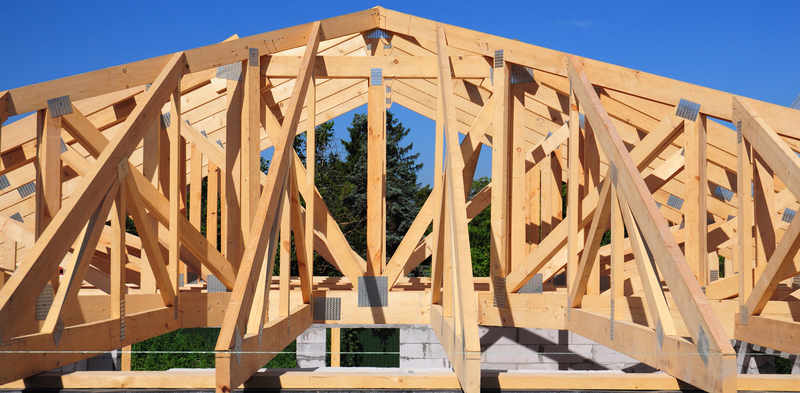 Hip roofs style trusses that demonstrate the lack fo free space in the attic
