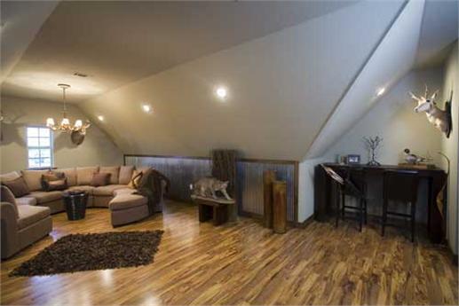 Bonus room with hardwood floors.