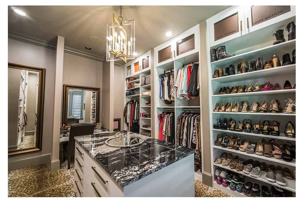 Spacious closet - and designed well with a compartment approach to storage and clothing and accessory placement