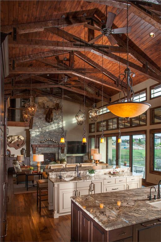 Striking kitchen opent othe the living. With high ceilings and exposed beams the home is full of character.