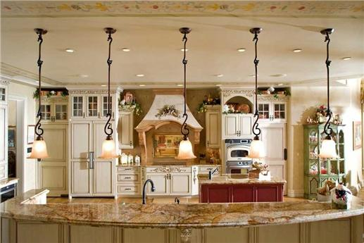 Opulent kitchen with large kitchen island and eating bar.