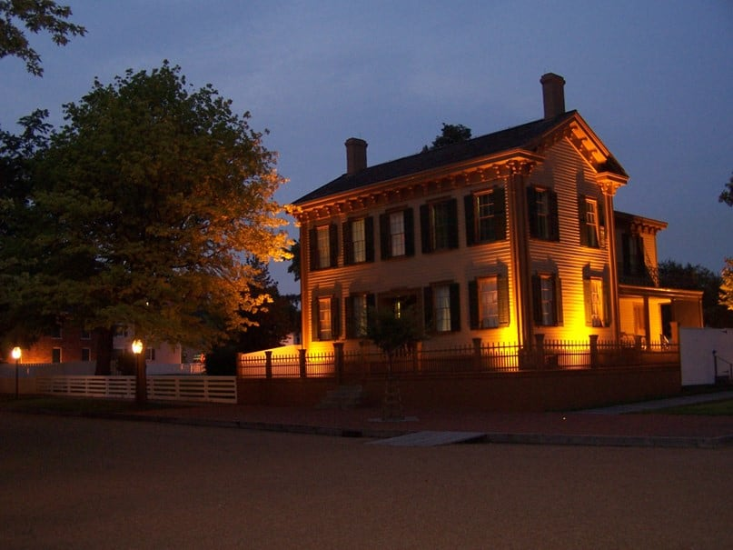 Lincoln's Greek Revival Two-Story Home in Springfield at dusk