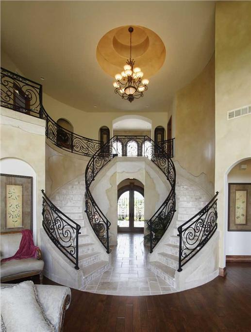 Luxurious double staircase foyer.