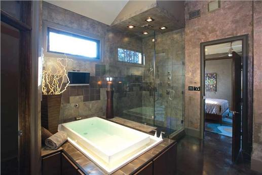 Huge master bathroom with walk-in shower and spa-like tub.