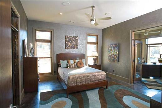 Master bedroom suite with luxurious bathroom.