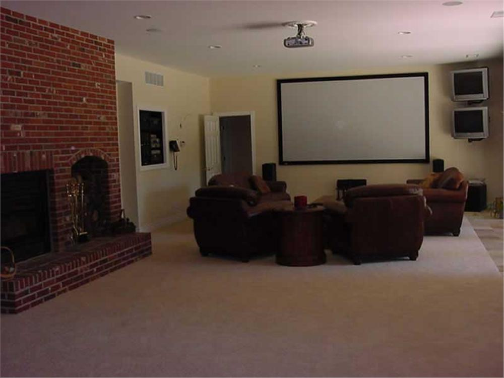 Neutral-decor media room with sophisticated mood lighting