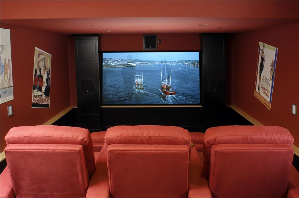 Modern, comfortable media room with state-of-the-art TV