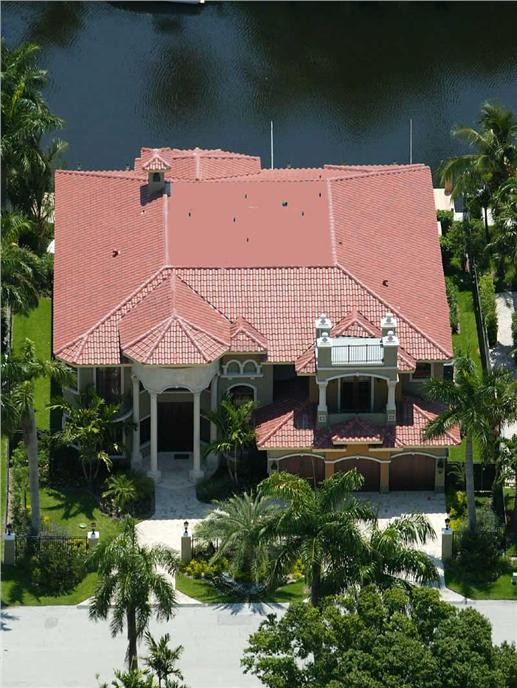 Luxury House Plans 107-1011 color photo aerial view.