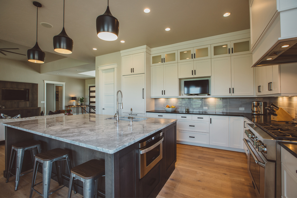 kitchen has an island made of granite dark cabinetry  its focal point