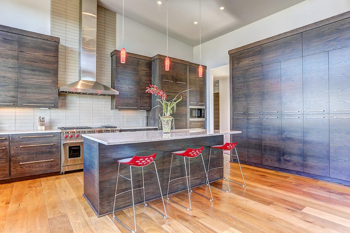 Modern, dark kitchen with splash of color and sleek lines