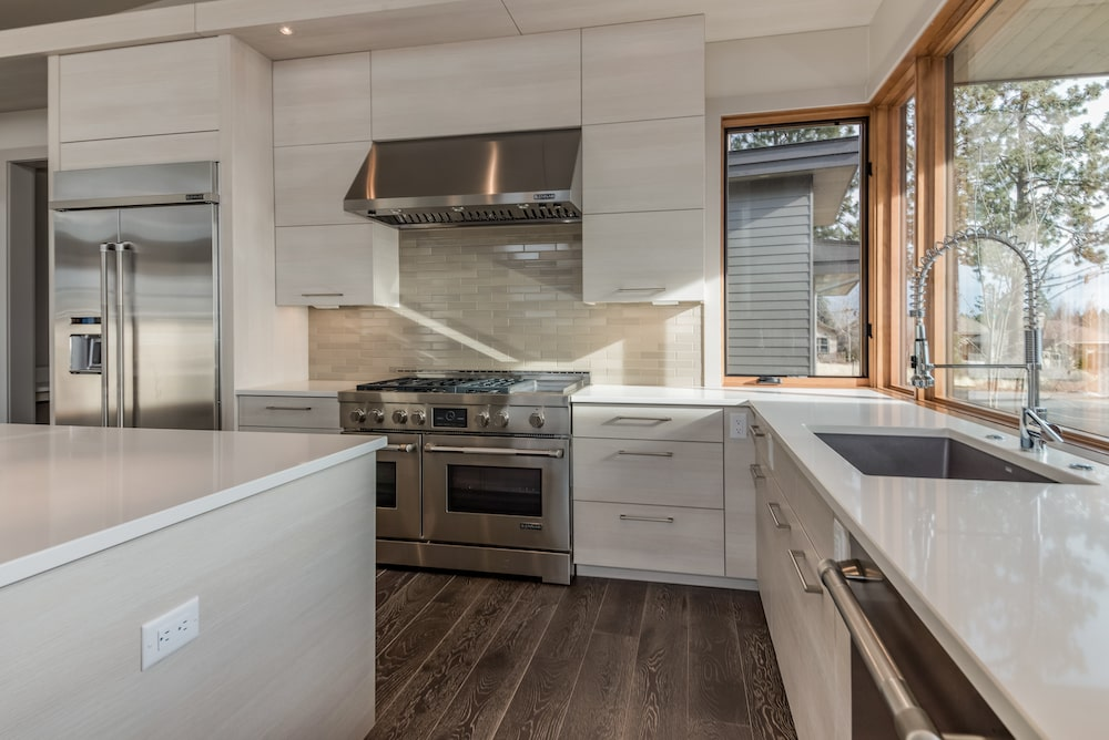 Modern, white kitchen with work triangle and plenty of space.
