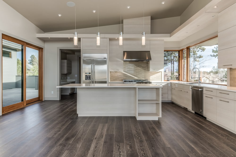 Modern white kitchen with lots of space - clean lines.