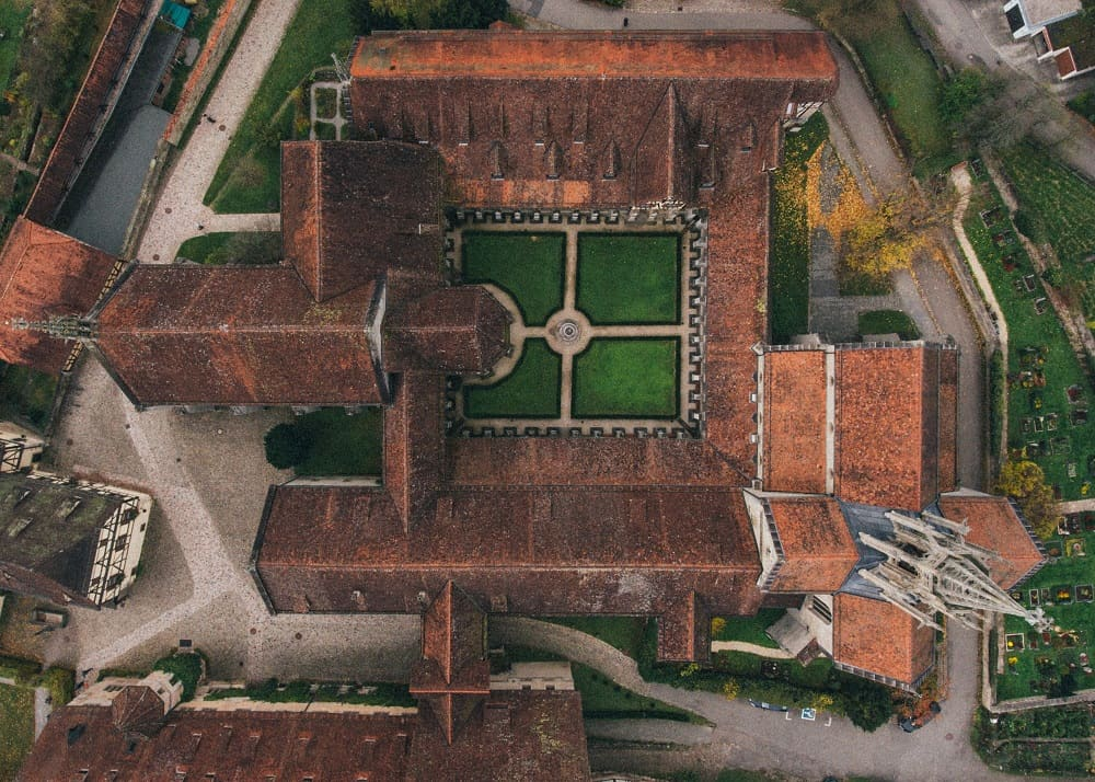 An aerial view of a German monastery with center court layout.
