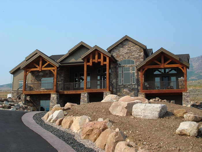 Impressive mountain-style home with stone and wood beam exterior