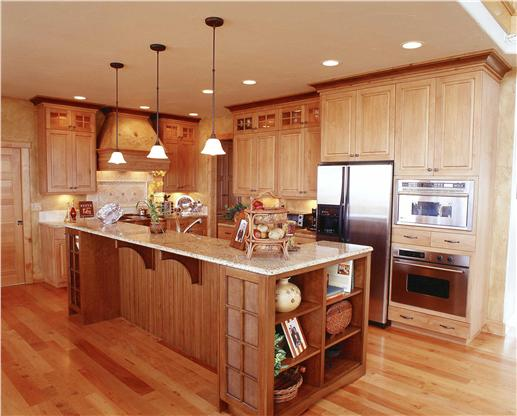 Country-style kitchen with large kitchen island.