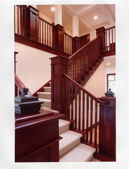 Wooden staircase to the second floor in roomy open-plan home
