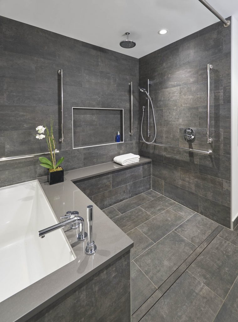 Super shower has everything going for it  space, grab bars, bench, and more