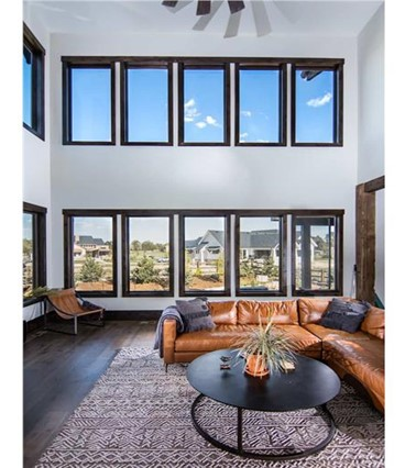 Vaulted living room with double rows of windows on two walls