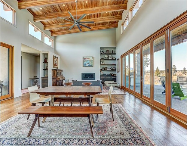 Great Room with vaulted ceiling, clerestory windows, and a wall of sliding glass doors