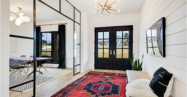 Spacious foyer in a gorgeous one-story, 2,686-square-foot Country home