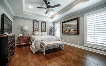 Master bedroom suite with fabulous 10-foot-tall tray ceiling