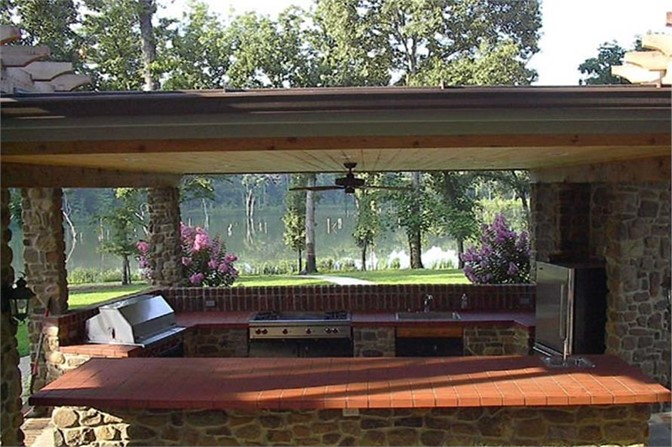 Outdoor kitchen with a great view, part of a European style home