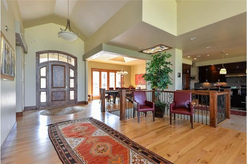 Beautiful basement staircase that separates the dining and kitchen area from the Great Room